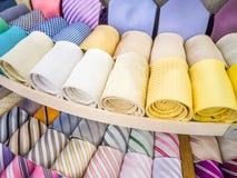 Many necktie rolls display Royalty Free Stock Photos