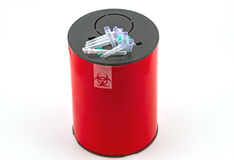 Many  needle in red disposal boxes on white background Royalty Free Stock Photos