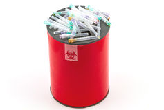 Many  needle in red disposal boxes on white background Stock Photography