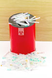 Many needle in red disposal boxes on white background Stock Image