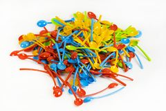 Many new colored plastic spoons Stock Images
