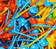 Many new colored plastic spoons Stock Photos