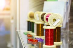 Many new of colorful wire coil on table with flare for electric industrial work royalty free stock photos