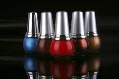 Many new nails polish on black Royalty Free Stock Photo