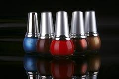 Many new nails polish on black Royalty Free Stock Photo