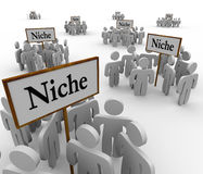 Many Niche Groups People Clustered Around Niches Signs. Several groups of people in niche markets gathered around signs gathering them into niches Royalty Free Stock Photography