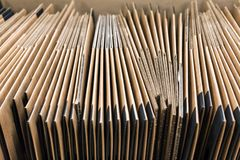 many non-assembled cardboard boxes Royalty Free Stock Images