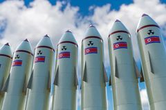 Many nuclear missiles with North Korean flag. 3D rendered illustration Stock Image