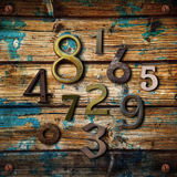 Many numbers on wooden background Royalty Free Stock Photography