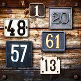 Many numbers on wooden background Stock Photo