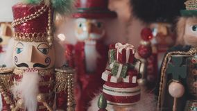 Lot of nutcrackers in a xmas decoration. Many nutcrackers in a christmas decoration before xmas, with lights stock video
