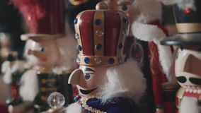 Lot of nutcrackers in a xmas decoration. Many nutcrackers in a christmas decoration before xmas, with lights stock footage