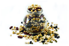 Many nuts overflow from the jar. Beautiful nuts overflows from a jar Royalty Free Stock Photography