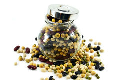 Many nuts overflow from the jar. Beautiful nuts overflows from a jar Stock Images