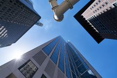Many office buildings as skyscrapers in Frankfurt am Main. In front of a blue sky Stock Photography