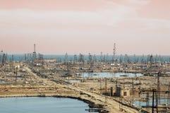 Many oil derricks. On the shore near Baku, Azerbaijan Royalty Free Stock Photography