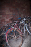 Many old or antique bicycles stacked in a garage Stock Photo