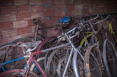 Many old or antique bicycles stacked in a garage Royalty Free Stock Image