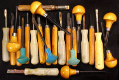 Many old art chisels on black background Royalty Free Stock Photos