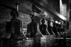 Many old bells seen in a row. Black and white image. The Belfry of Ghent, Belgium.  stock images