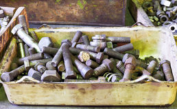 Many old bolts on workbench in turnery Royalty Free Stock Photos