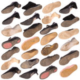 Many old boots on white Royalty Free Stock Photography