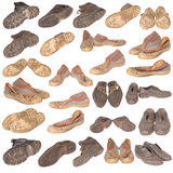 Many old boots on white Royalty Free Stock Photo