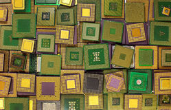 Many old CPU chips and obsolete computer processors as background Stock Photos