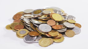Many old different coins heap rotating over white stock footage