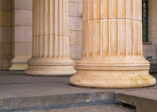 Many old greek columns in a row Royalty Free Stock Photo