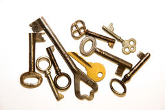 Many old keys to the safe on a white background Royalty Free Stock Photos