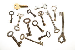 Many old keys to the safe on a white background Royalty Free Stock Images