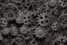 Many old rusty metal gears background. Many old rusty metal gears or machine parts Stock Photos