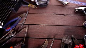 Many old rusty tools and modern tablet on desk stock video