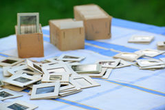 Many old slides on the table in garden Stock Image