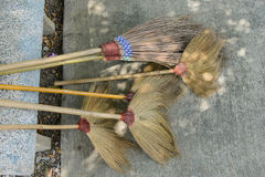 Many old straw broom on the floor Royalty Free Stock Image