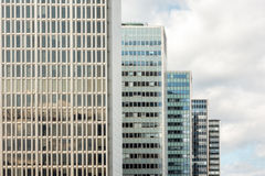 Many old tall office buildings in a row with cloudy sky. Royalty Free Stock Photos
