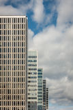 Many old tall office buildings in a row with coudy sky. Stock Photo