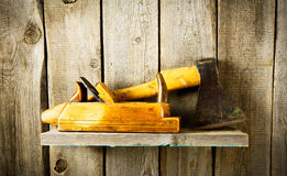 Many old tools (axe, plane and others) on a wooden Royalty Free Stock Photos