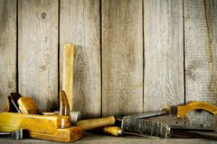 Many old tools (plane, mallet and others) on a Stock Photo