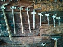 Old tools on brown wood floors. Many old tools used to be hung on brown wood floors stock image