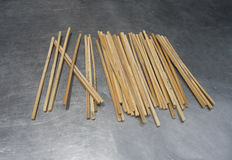 Many old traditional chopsticks put on metal table to desiccation.  stock images