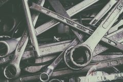 Many Old and Used Box Wrench in the Tools Box in the Garage. Vintage Style Picture Added stock images