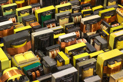 Many old used electrical ferrite power transformers Royalty Free Stock Image
