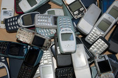 Many old and very used mobile phones. Lots of old and very used mobile phones stock photos