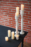 Many old white candles on old black table Royalty Free Stock Images