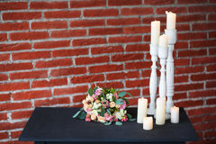 Many old white candles on old black table Royalty Free Stock Photo