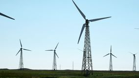 Many old wind turbine generators on green grass. Built in the Soviet Union