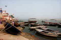 Many old wooden river boats on the bank of Ganges waiting for the tourists and the passengers Royalty Free Stock Image