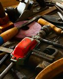 Many old working tools (axe, drill, saw and others. The old working tool. Many old working tools (axe, drill, saw and others) on a wooden background Stock Photography